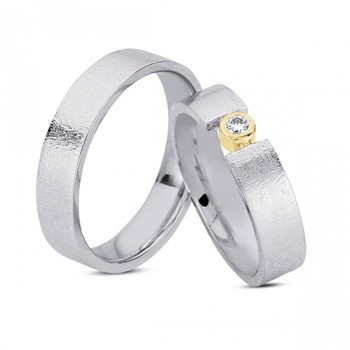 Silver wedding rings with 14 carat gold and diamond