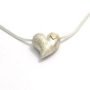 Silver heart pendant w/ small 14 ct heart
